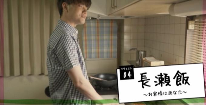 キッチンに立っている男性